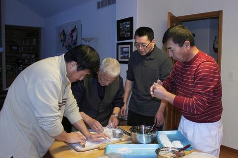 Three dads and a grandpa hard at work